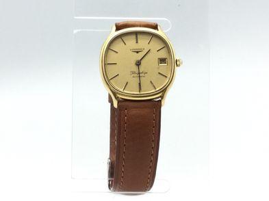reloj de oro longines flagship