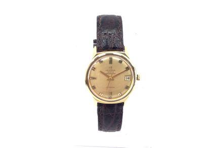 reloj de oro universal geneve polerouter automatic date  microrotor calibre 69