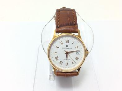 reloj de oro universal geneve u-1027